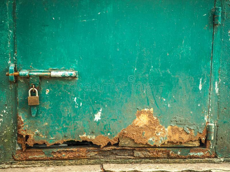 Old and rusty green iron doors.  stock photo