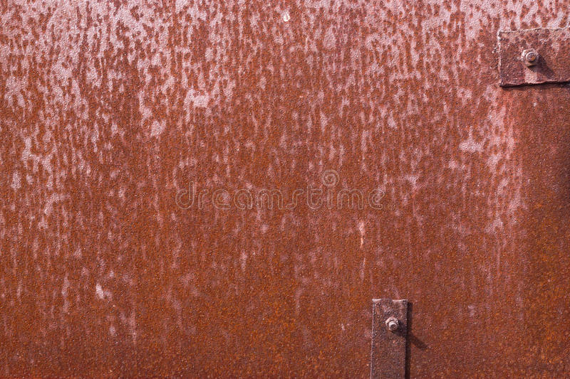 Old rusty grunge iron with metal rivets texture. D background stock photos