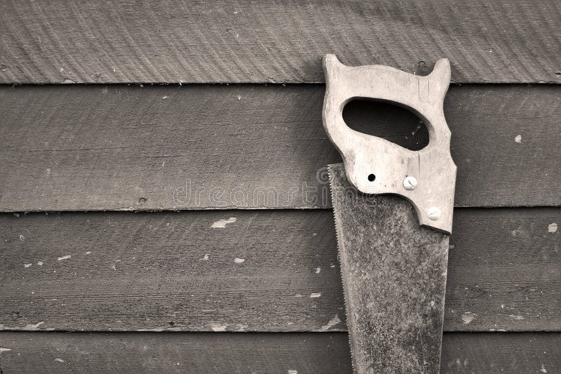 Old rusty hand saw royalty free stock photo