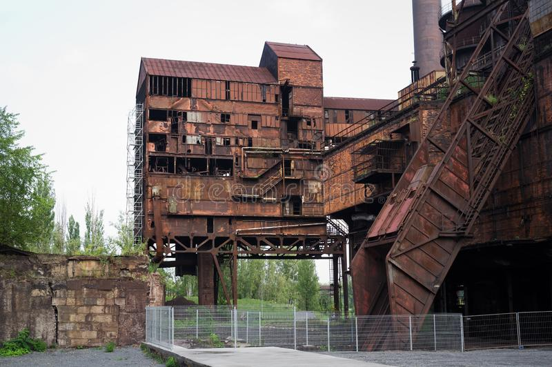 Old rusty industrial builing in The Lower Vitkovice, Ostrava, Czech Republic / Czechia. Ruin of abandoned historical mettalurgy industry royalty free stock images