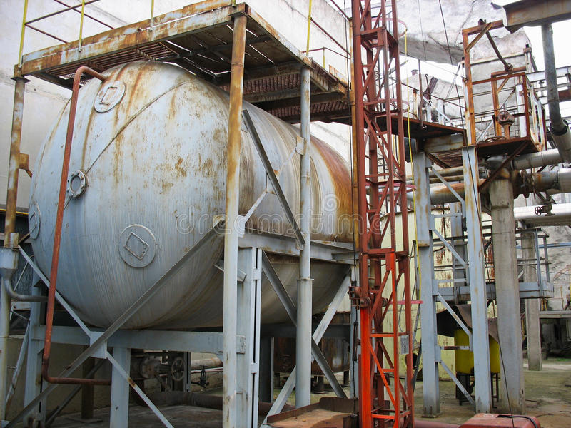 Old rusty industrial chemical tank stock image
