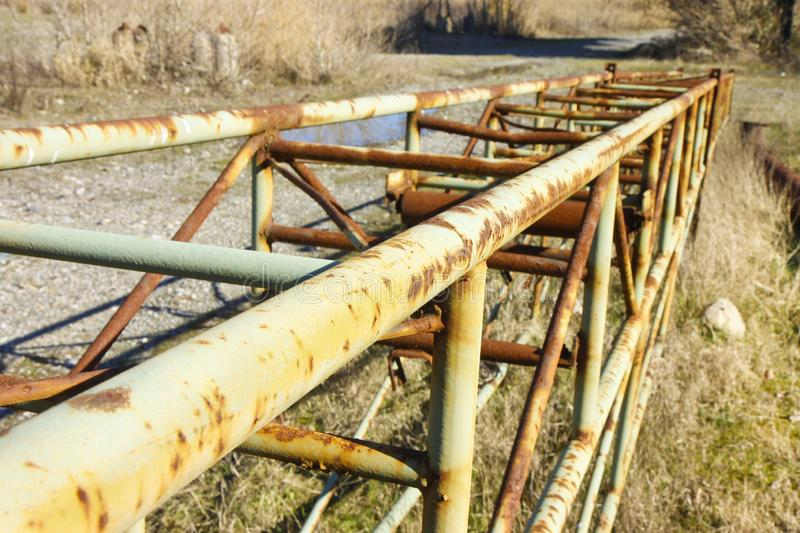Old rusty iron reticular structure with metal tubular profiles stock photography