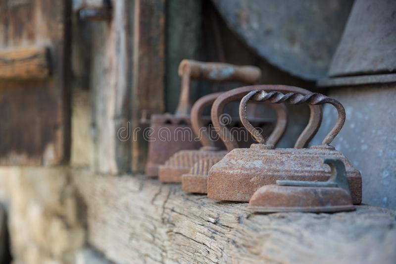 Old rusty irons. Retro domestic tools. Vintage irons in Lagich, Azerbaijan stock images