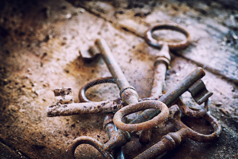 Old rusty keys on a wooden table stock images