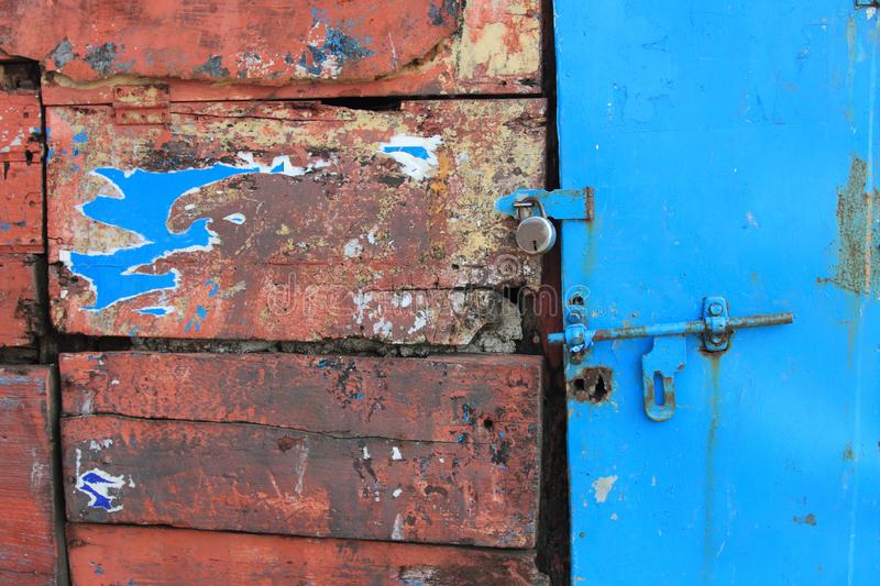 Old rusty latch on a wooden door stock images