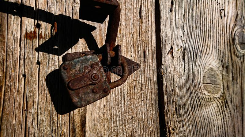 Old Rusty Lock On A Ancient Door. Old Rusty Lock On A Ancient stock images