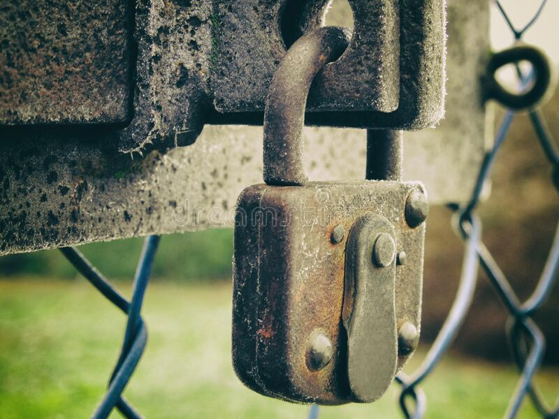 Old rusty lock on a fence. Abstract Old rusty lock on a fence royalty free stock images