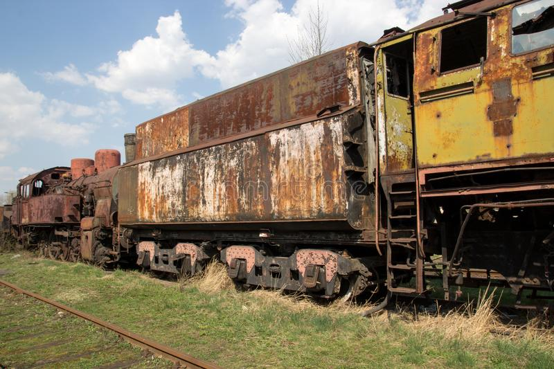 Old rusty locomotives and cars royalty free stock photography