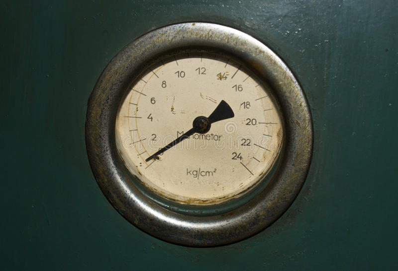 Old rusty manometer. Old vintage rusty manometer instrument stock photo