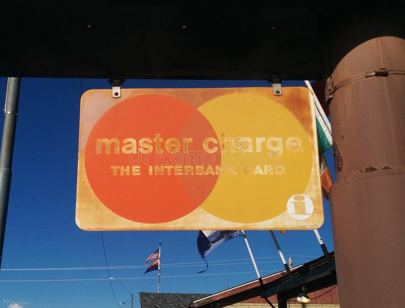 Old rusty Master Charge credit card sign royalty free stock images