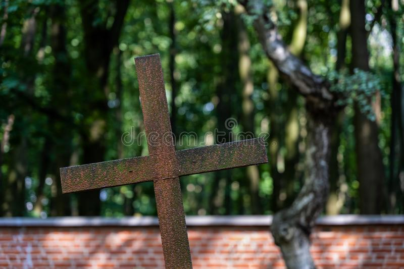 Old Rusty Metal Cross In Cemetery royalty free stock image