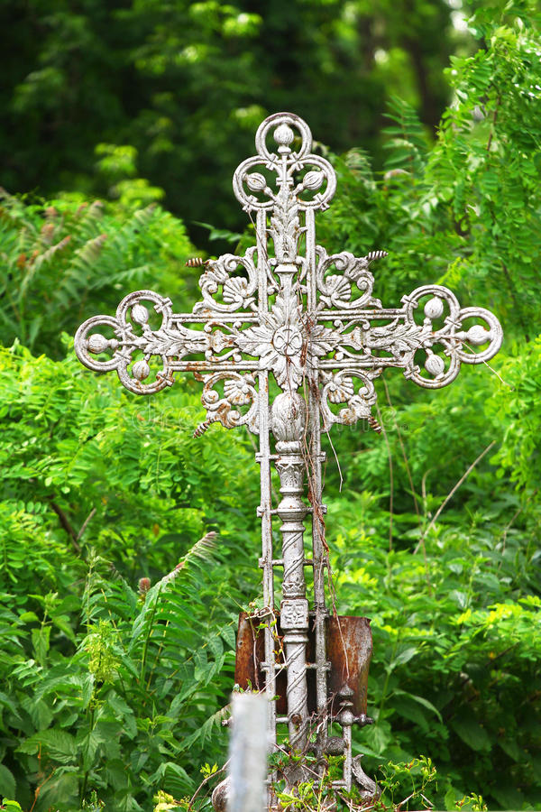 Old rusty metal cross in a cemetery stock photos