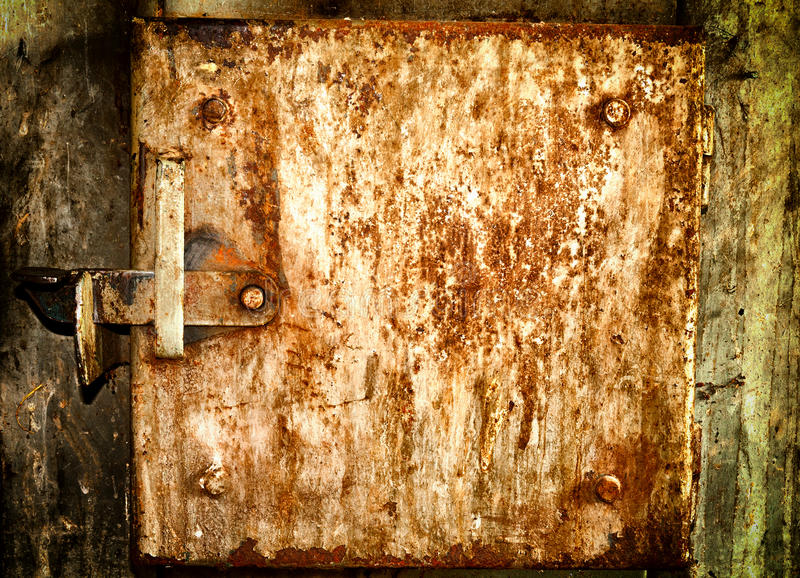 Old rusty metal doors texture or background. Old grunge rusty metal doors texture or background stock photos