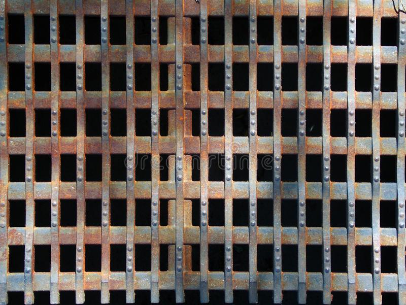 Old rusty metal drain grate royalty free stock photography