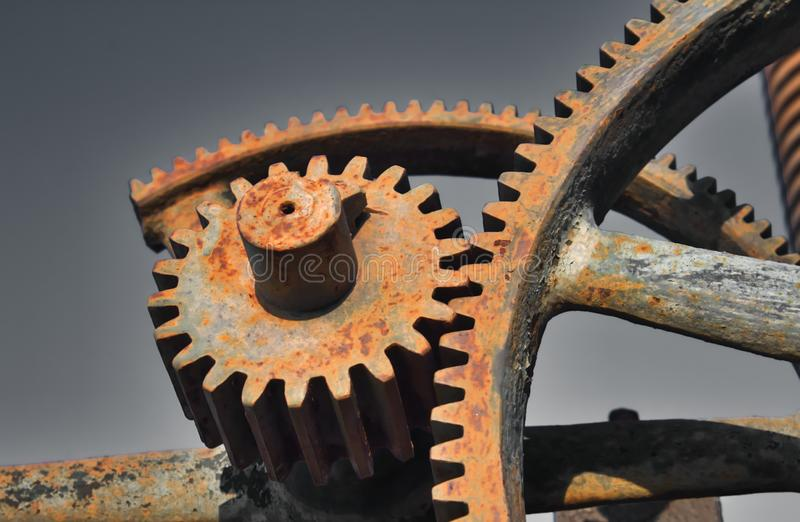 Old rusty metal industrial gears or cogs used in machinery royalty free stock images