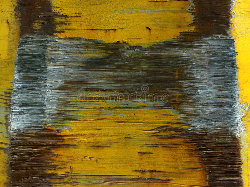 Old rusty metal texture painted with yellow pain stock image