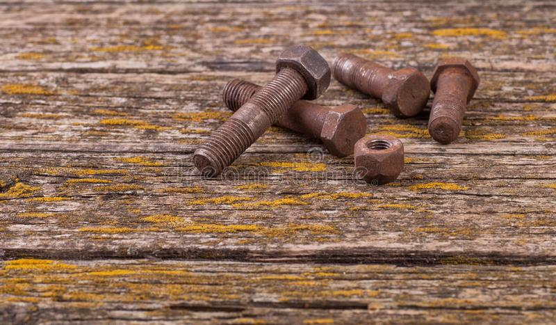 Old rusty nuts, bolts. Ancient tools. boards royalty free stock photos