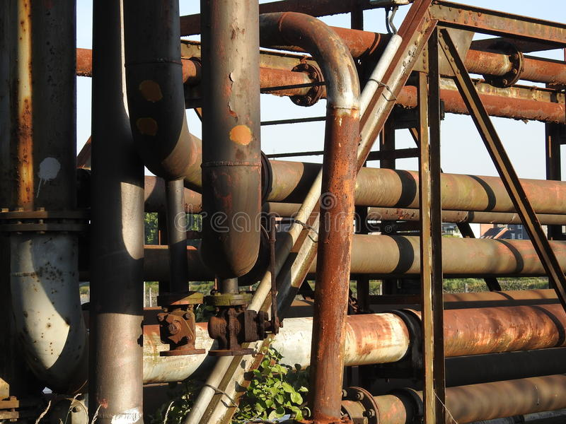 Old rusty oil pipes. Old oil pipes used to pump the oil from ship to refinery royalty free stock image