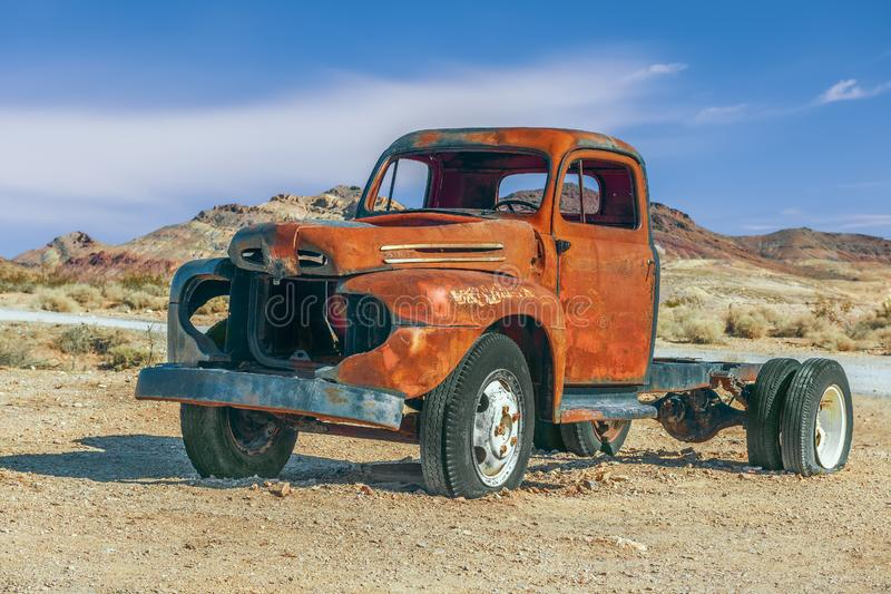 Old rusty pick-up truck in Rhyolite ghost town.Nevada.USA. Old rusty pick-up truck in Rhyolite ghost town. Nevada. USA stock images