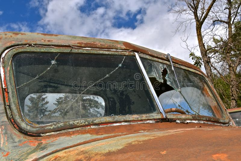 Broken windshield of an old pickup royalty free stock photography