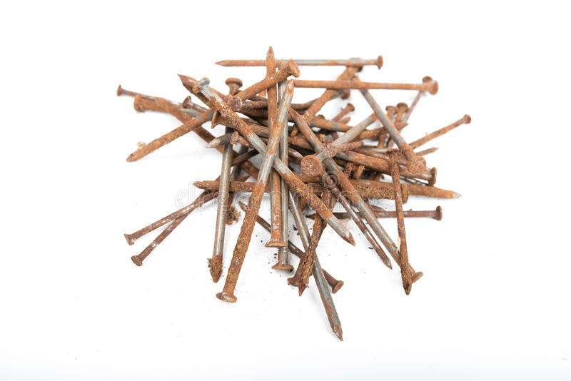 Old rusty pile of iron nails isolated on white background royalty free stock photo