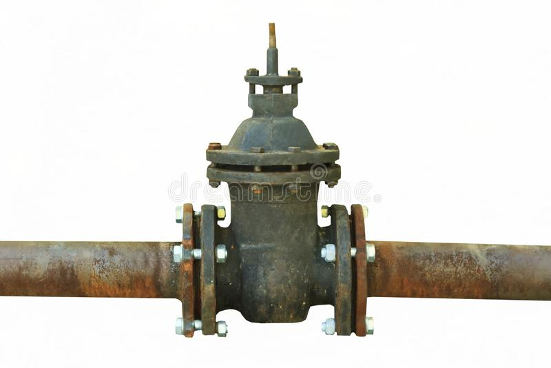 Rusty pipe with shut-off valve over green grass royalty free stock images