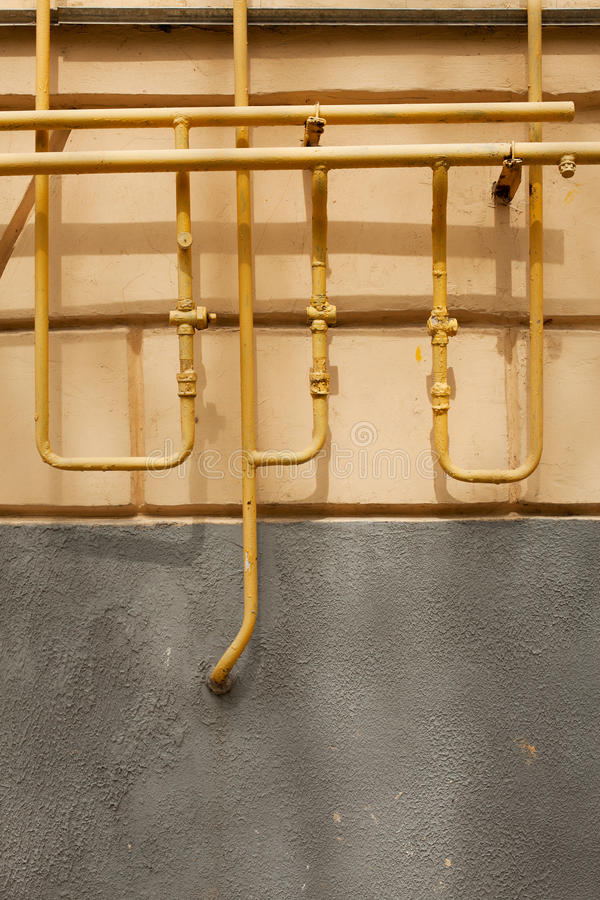 Download Old Rusty Pipes Against A Wall Stock Photo - Image: 24526184