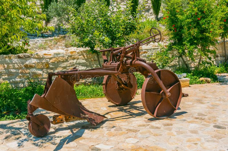 Old rusty plow for tillage. Local historical landmark royalty free stock images