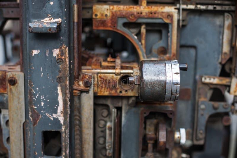 Old rusty printing machine complex mechanism of metal stock photos