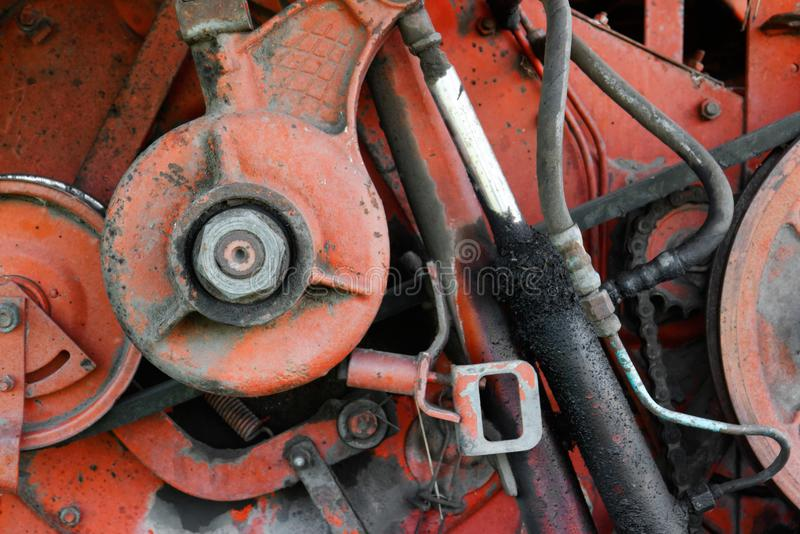 Old rusty red oily machinery. Conceptual closeup. Old rusty red oily machinery royalty free stock photography