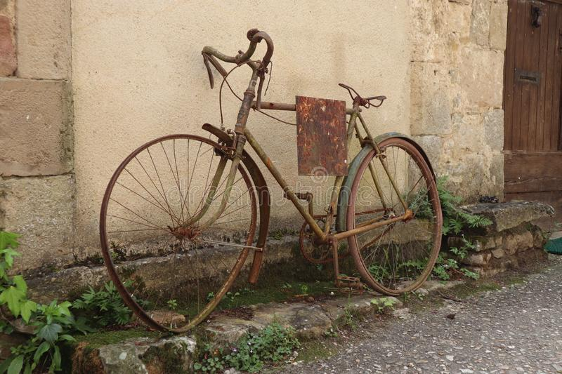 Old and rusty road bike. Vieux velo rouillé france french roue voilée bent wheel royalty free stock images