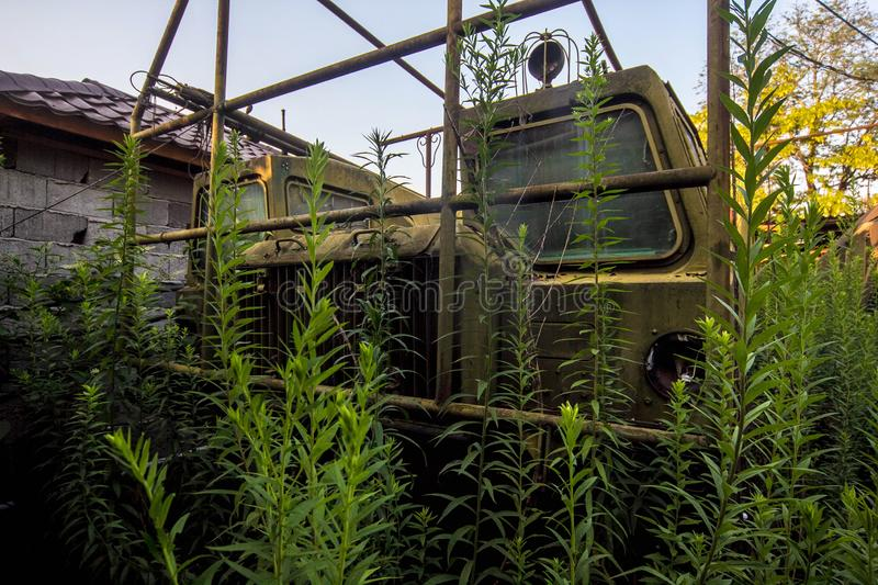 Old rusty rocket tractor in abandoned overgrown military base stock photo
