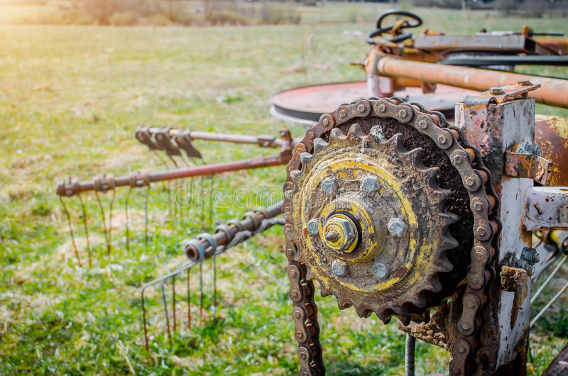 Old rusty species of part of agricultural machinery in rural areas. stock photo