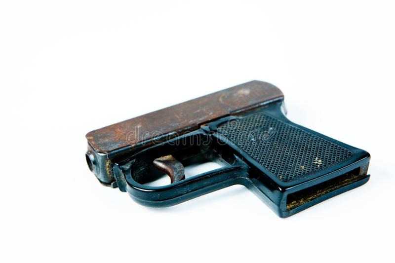 Old rusty starting pistol with black plastic grip. Bottom view royalty free stock photography