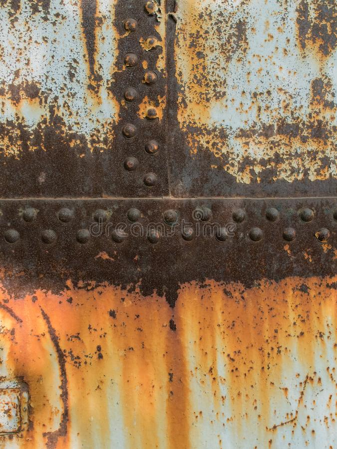 Rust metal texture with rivets, abstract grunge background stock photo