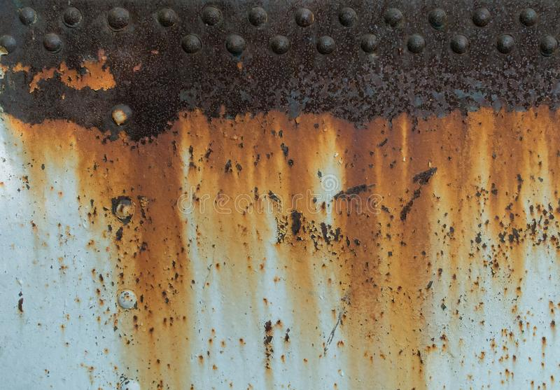 Metal rust texture with rivets, abstract grunge background stock photos