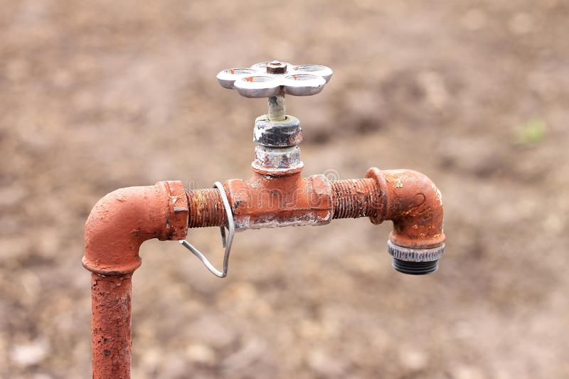 Old rusty tap for water with a valve, the water does not run out of it stock image