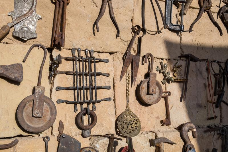 Old rusty tools, homeware and iron souvenirs for sale at flea market. Old rusty tools, homeware and iron souvenirs for sale at bedouin flea market stock image