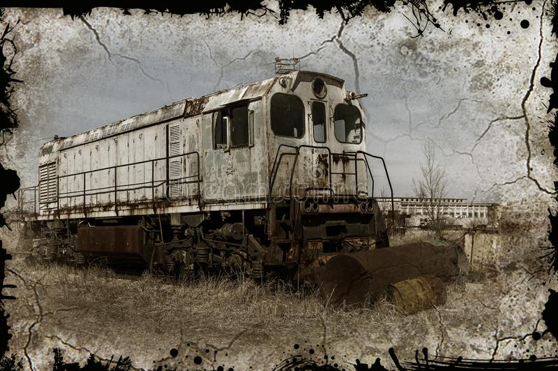 Old rusty train locomotive thrown into exclusion zone of Chernob stock image