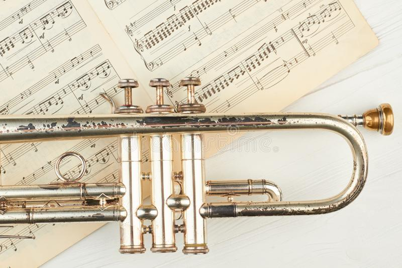 Old rusty trumpet and musical notes. stock photography