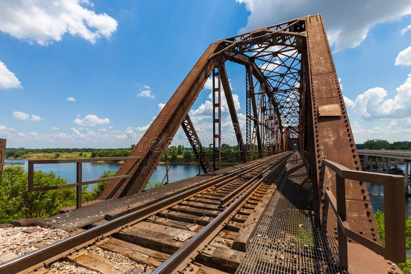 Old rusty truss railroad bridge over the Red River on the border stock photo