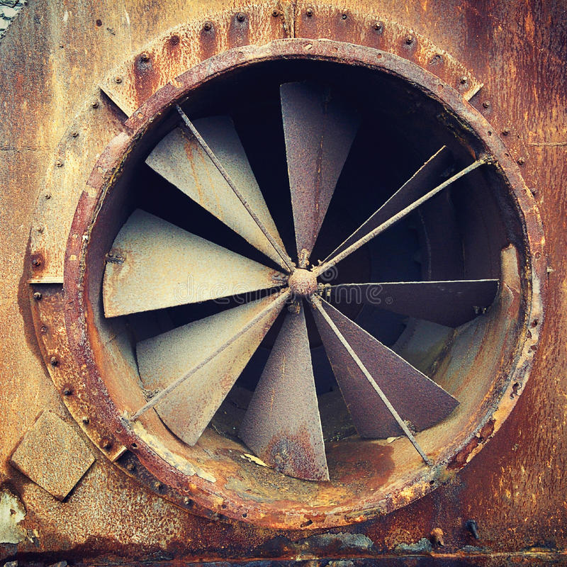 Old rusty turbine made from metallic materials. Near Tallinn sea port at old electric station stock photos