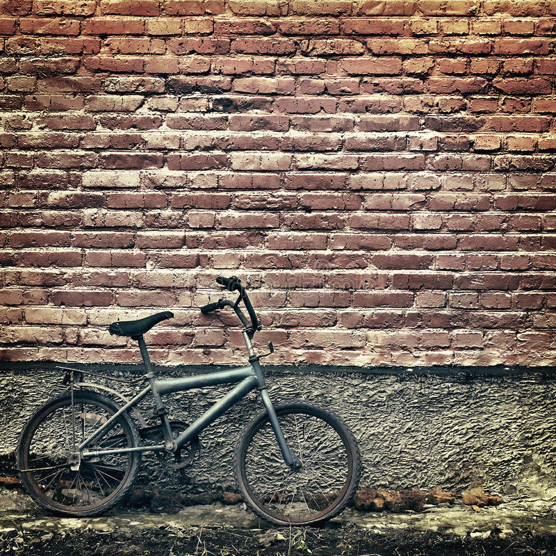 Free Old Rusty Vintage Bicycle Leaning Against A Brick Wall Royalty Free Stock Photo - 49660165