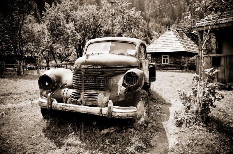 Old rusty vintage car - sepia royalty free stock photos
