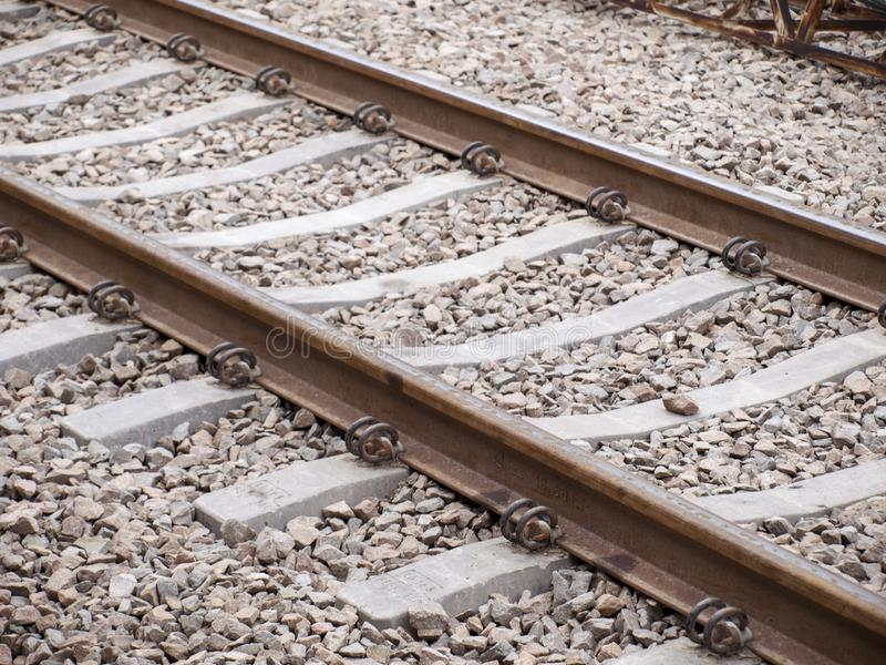 Old rusty vintage railroad track, high constrast, rail transportation concept stock photo