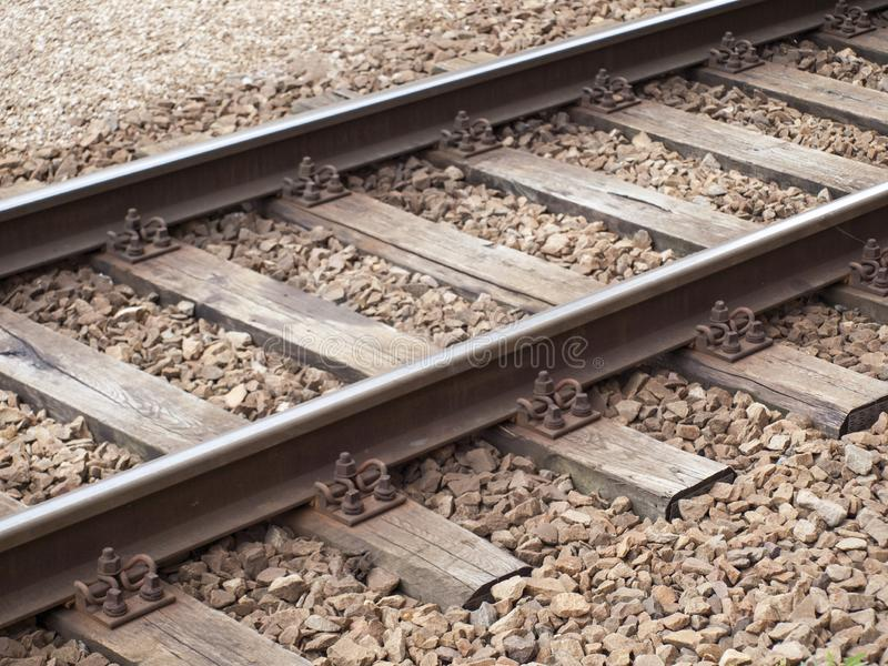 Old rusty vintage railroad tracks closeup, rail transportation concept stock photography