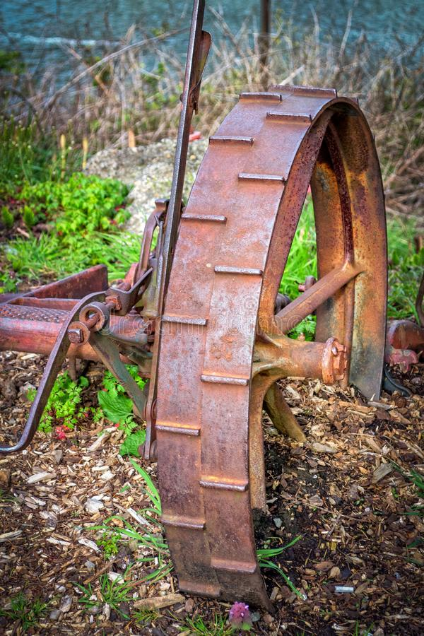 Antique rusty farm implement wheel royalty free stock photography