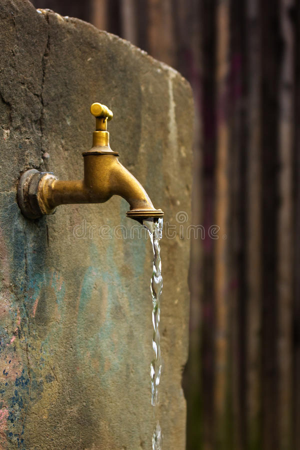 Old rusty water tap royalty free stock image