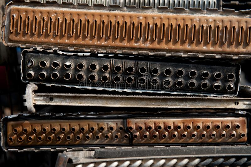 Old radiators from car on scrap yard. Old rusty and weathered radiators from many cars on scrap yard in day light stock photos