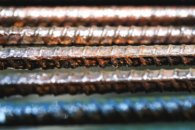 Old rusty and wet iron grate in close up picture. Wet iron fence. Background at prison. Vintage old metal bars or industrial wet rusty security bar in macro royalty free stock photos